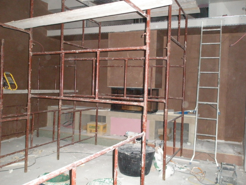 It is difficult to see with all the scaffolding in the way, but we have plastered about half of the fireplace.  The remaining bits of the lounge (including the ceiling) will be finished off tomorrow.
