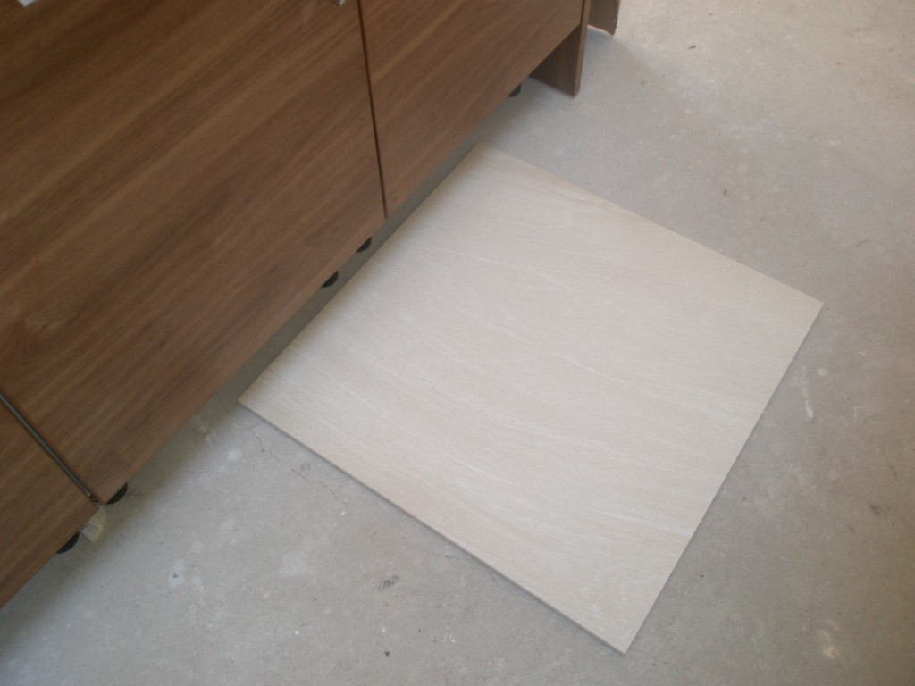 This is one of the kitchen tiles laid next to the new units.  These tiles are 60x60 cms and are shipped 4 in a box.