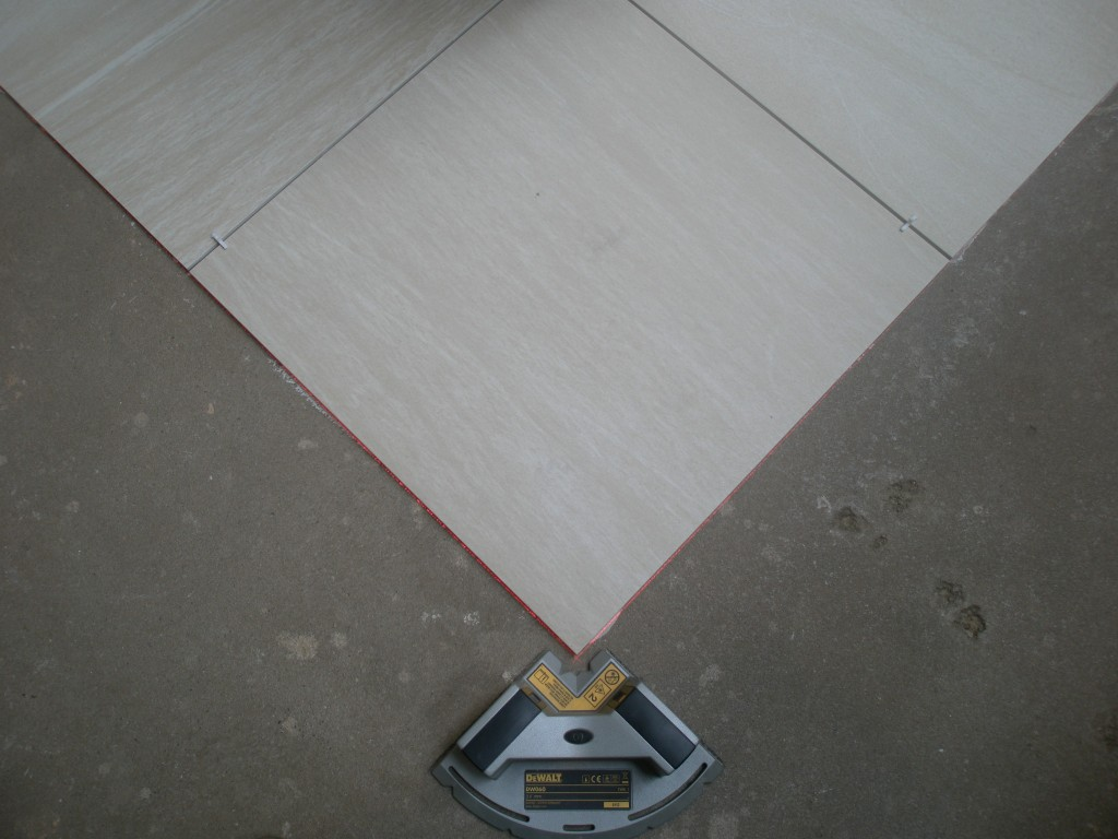 Using a laser to lay the tiles.  This ensures that the tiles are perfectly lined up.