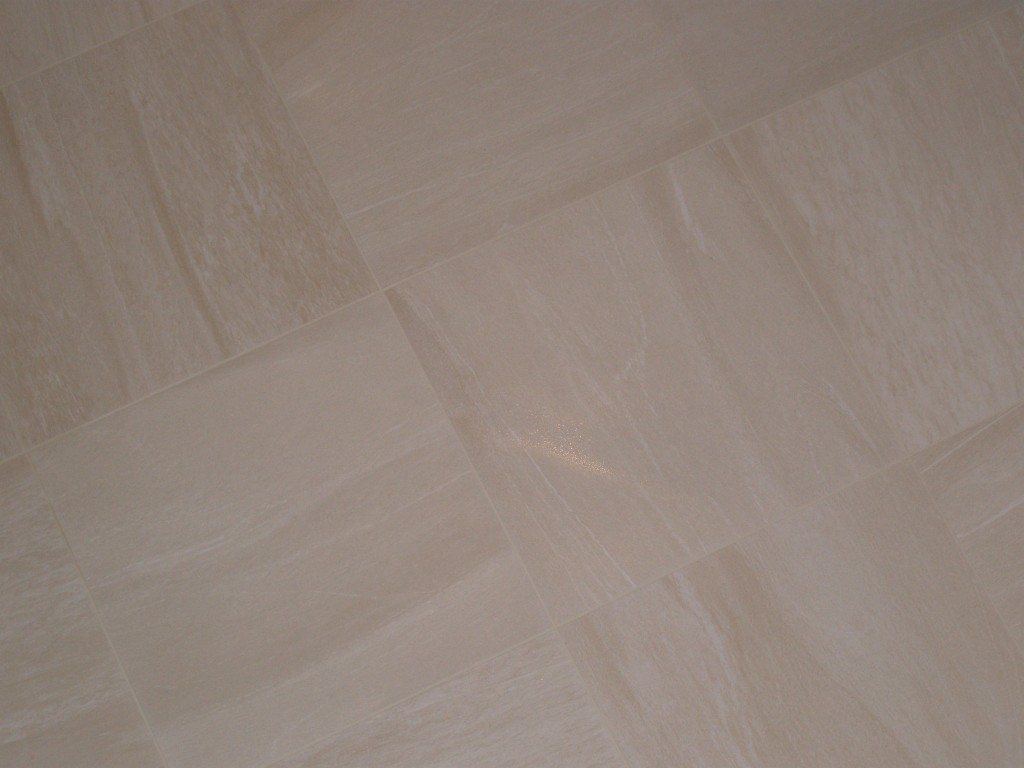 It is difficult to see here, but we are using jasmine white grout to blend in with tiles.  These should be dry enough to stand on tomorrow and then we can turn the underfloor heating on in about a week (we need to give the tile adhesive time to go off completely).