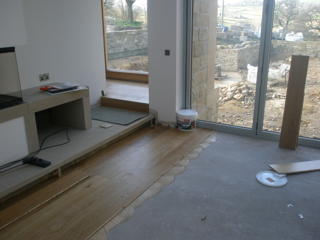 We have started putting the timber flooring down in the lounge.  The underfloor heating in here has been off for the last week or so since it is on the same zone as the kitchen where we have been tiling the floor.