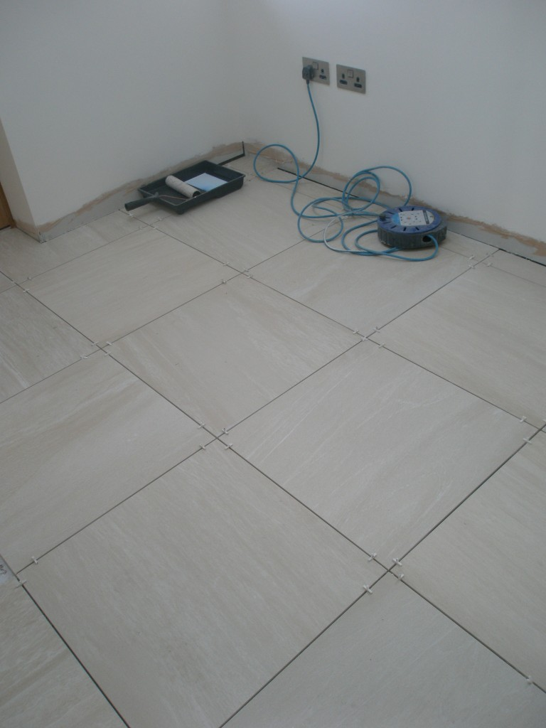 We have used the same tiles in the boot room and utility room.  These still have to be grouted.