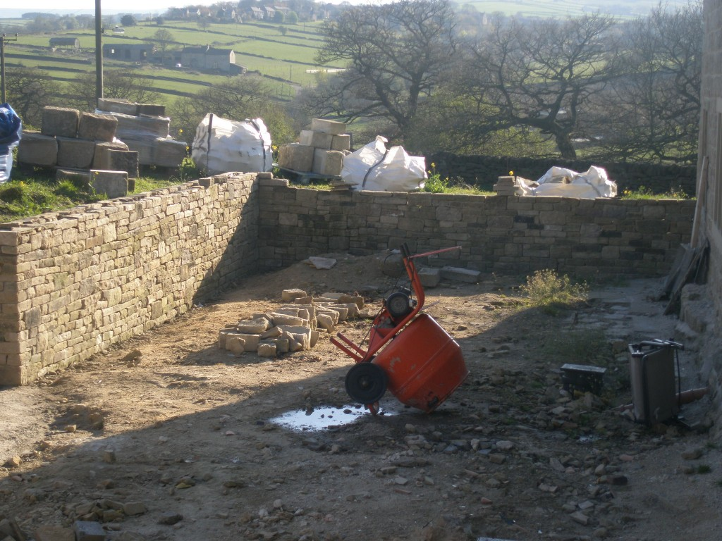 We still need to get the end wall up to the same level before we can put the topping stones on.  We decided to invest in a second-hand cement mixer.