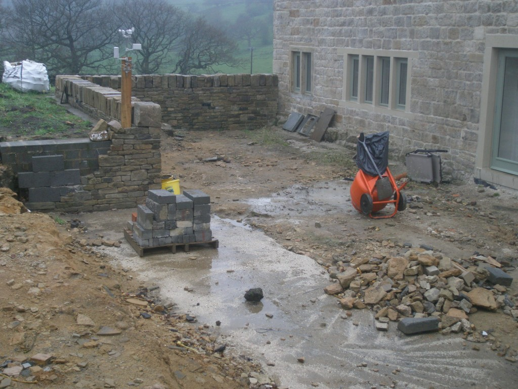 We have  not built up part of the wall in the back garden.  This is to allow access to get the flagstones into the garden.  It is going to be a couple of months before we get around to laying the flags.