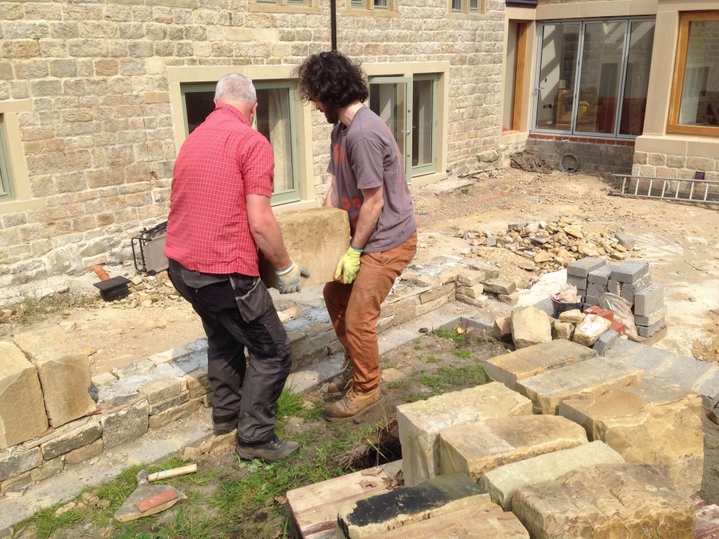 Placing these large topping stones is definitely a two man job.  They vary in weight, but are probably in the 50-75Kgs each.  These is me and Liam carrying one into position.