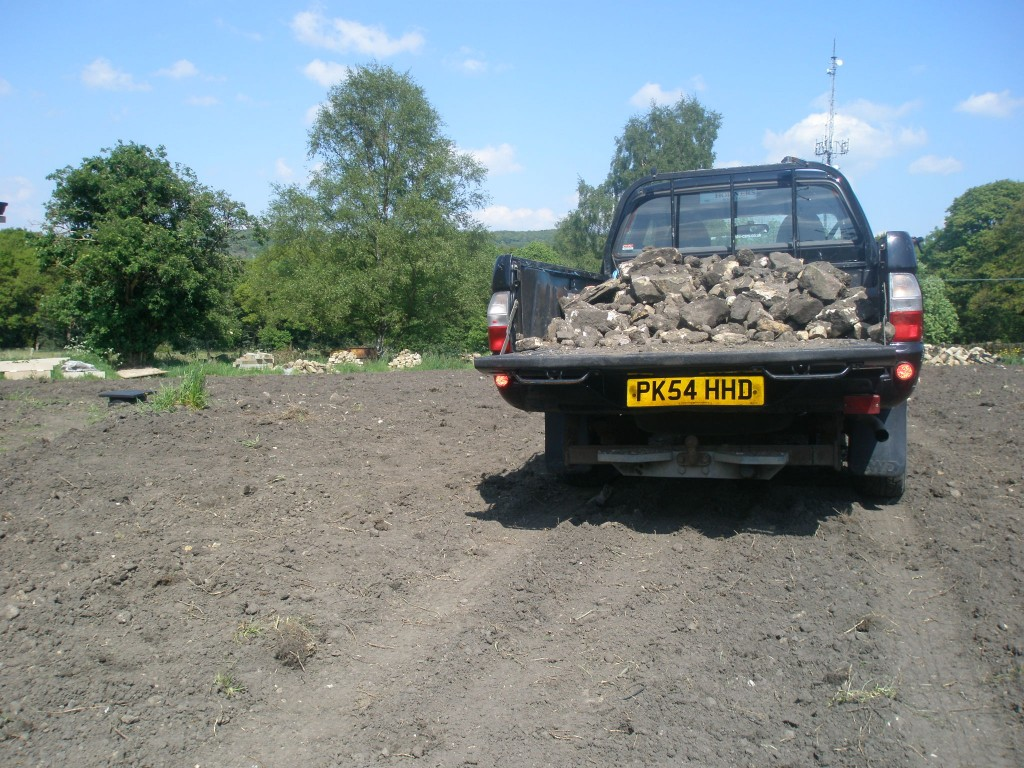 By the time we had filled up the truck for the second time, we had got about half way through the job of removing the stones.  While Jo is back off down to London on Monday, it is one of my tasks for the week to get this finished off so we can get the seed down.
