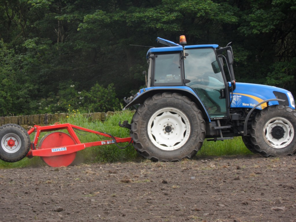 Once the seed has been drilled into the soil, it is then rolled.  Apparently, the more the soil is rolled the faster the germination.  It will also keep deter the birds slightly.