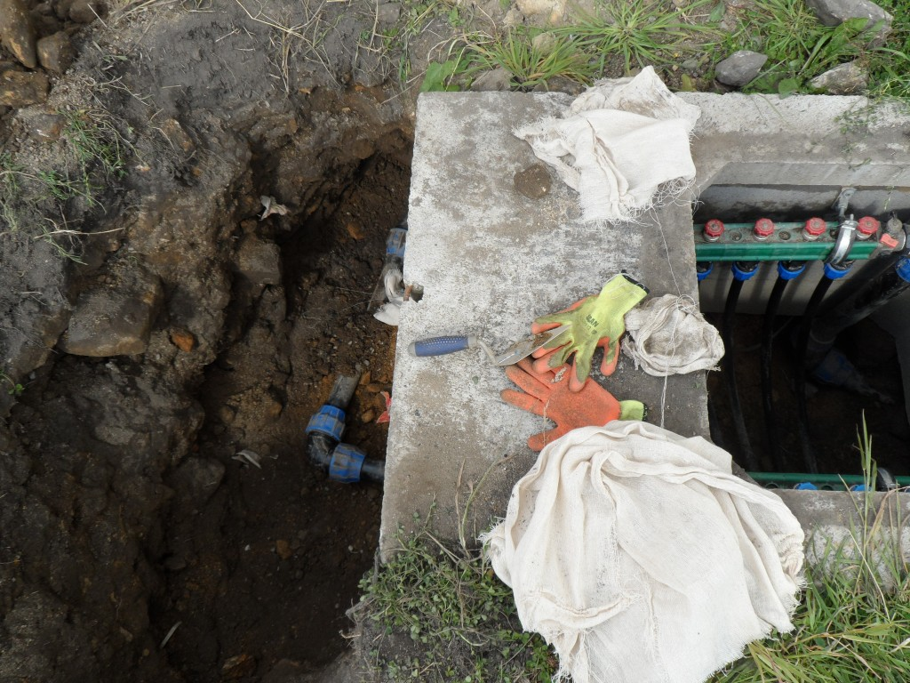 Unfortunately, not all of the joints are accessible via the manholes.  This means if you want to check them, then a hole (a big one) has to be dug.  This one was dug by hand.