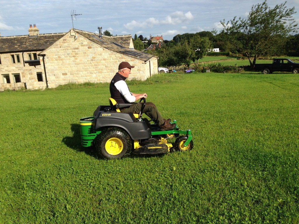 If Daleks could mow grass, this is what it would look like!  It feels a bit like driving a large motorised wheelchair.  We need to shoot some video and post it.