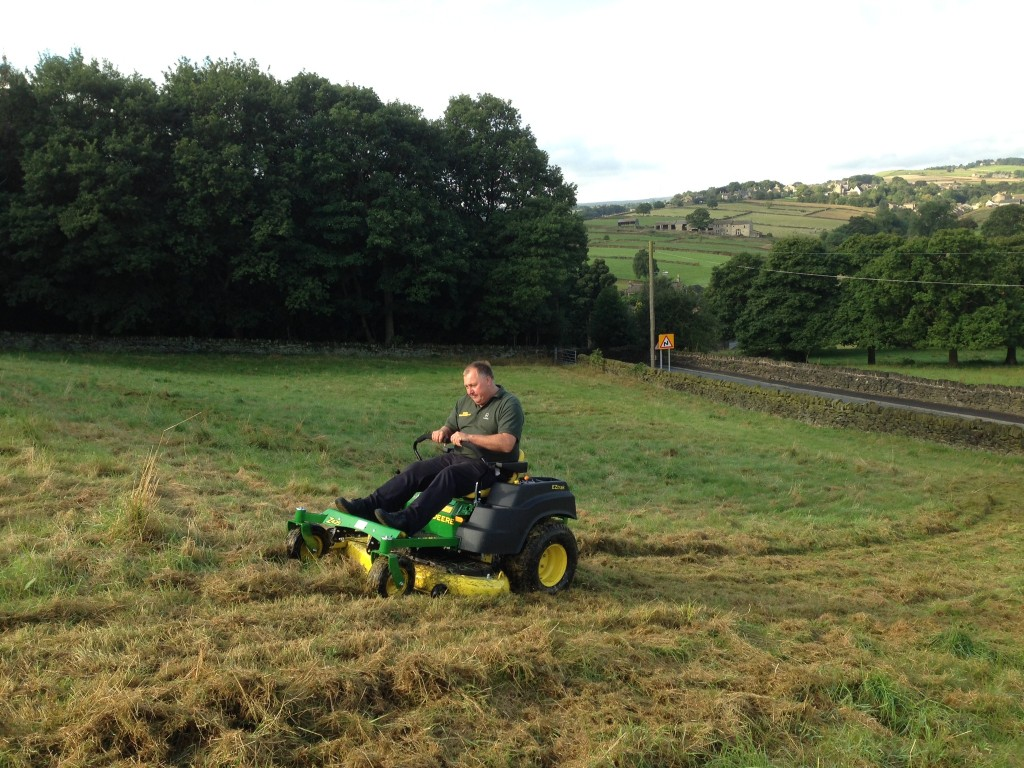 Adrian from Bob Wild Grass Machinery demonstrating the John Deere Z425 on the slope in the bottom field.  This machine is a lot more stable (and a lot quicker) than a compact tractor and topper.  Adrian actually demonstrated that it is possible to cut along the slope with this machine.  The slope doesn't look much in these photos, but it feels steep when you are on it!