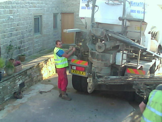 One of the pictures off one of our security cameras.  The concrete is mixed as it is delivered by the machine.  The concrete is metered so you only have to pay for what you use.  We thought we only needed about 1 cubic meter, in the end we required 1.75 cubic meters!  If you order it the traditional way, you would over order to guarantee that you have enough to finish the job.  This isn't great but it is better than being short!  However, it does mean that you frequently have surplus concrete to get rid of at the end of the job.