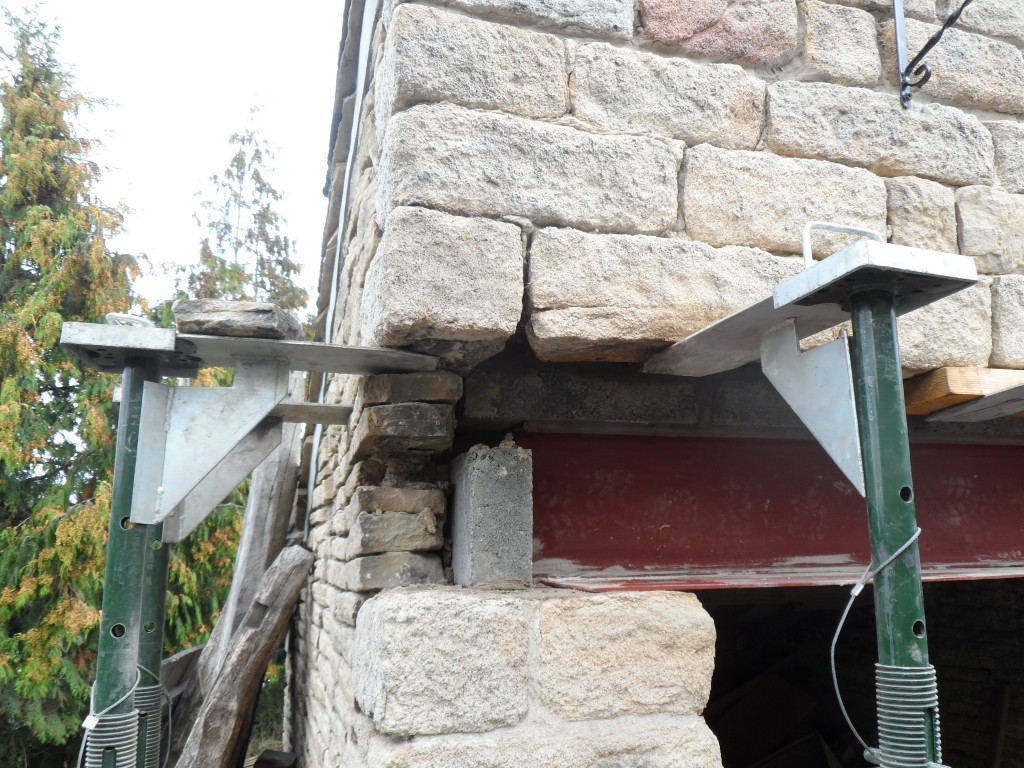 The new lintel consists of an I beam with a steel plate welded to the bottom.  From the inside you will see the back of the I beam, but you will not see any of the beam from the front.  The stonework will be replaced exactly as it was and the edge of the steel plate will be lost in the pointing between the courses.