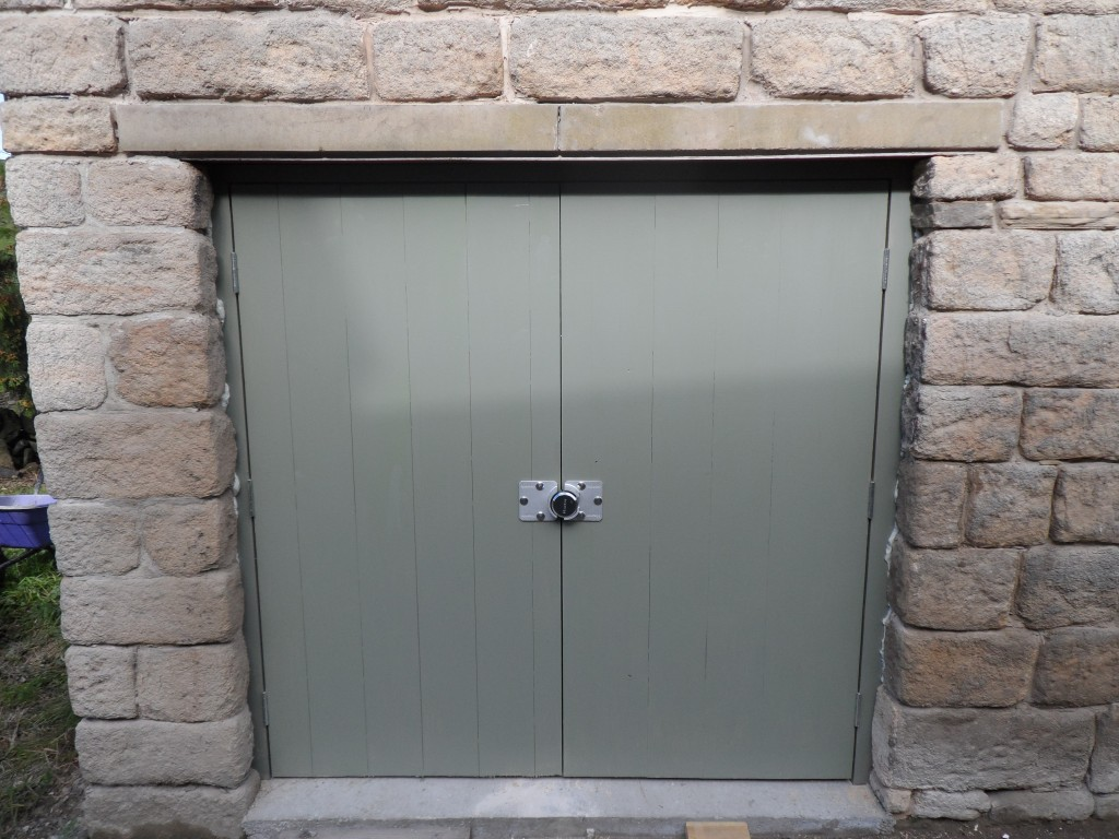These locks are intended for the rear doors on vans, however, they are a neat solution for a shed door.  This one looks a little over sized for this door, but it does the trick.