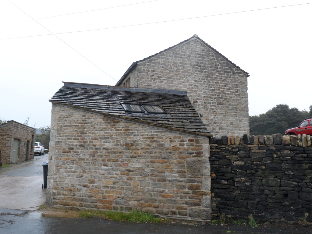 The left hand side of this south west gable was treated with Belzona 5122.  On this particularly wet day, you can see the difference it is making to the way the stonework is absorbing the water.