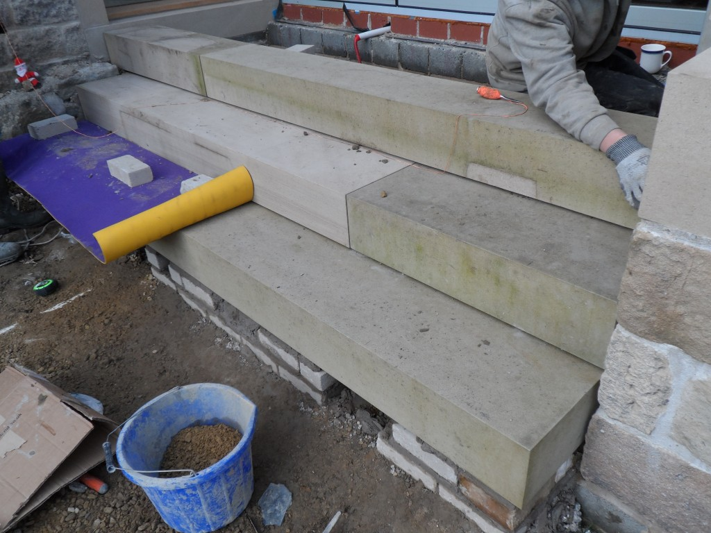 These steps look great - big and chunky, but very heavy.  Everyone is relieved to see these in place.
