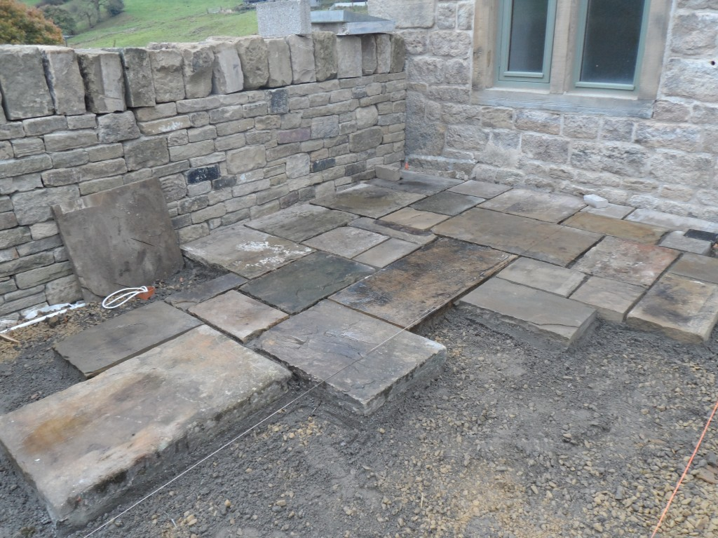 "The flags are of varying quality, but this all adds to the rustic feel of this space.  The worst of the flagstones we are putting to one side and will return the reclamation yard for them to be replaced - they are so rough, they are a ""trip hazard""!"