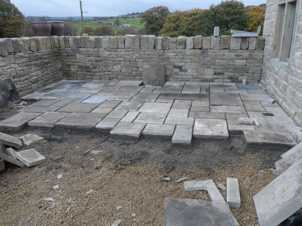 End of day 2 laying flagstones and we reckon that about 20 sq yards has been laid.  A rough calculation would seem to indicate that it will take most of the coming week to get all of the flagstones laid on the lower part of the sunken garden.