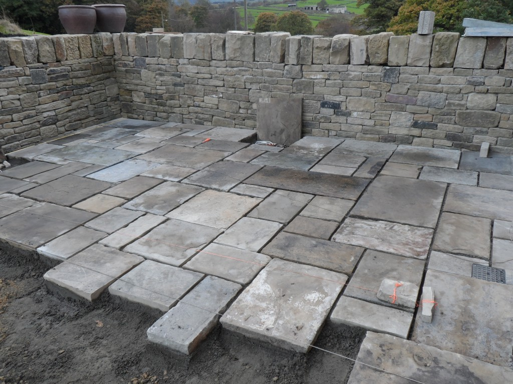 Two days in and Paddy and Jonny have laid about 20 sq yards of flagstones.  By the end of the coming week, the lower terrace should be finished (in terms of laying the flagstones).