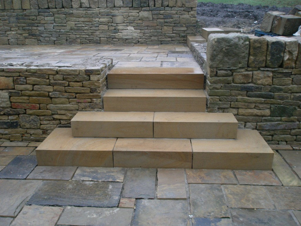 It would have been easy just to have put 1200mm wide steps in here, but it looks so much better with the bottom steps extended outwards.  The reclaimed walls could do with being pressure washed to remove some of the old paint and dirt but they contrast with the new stone steps.