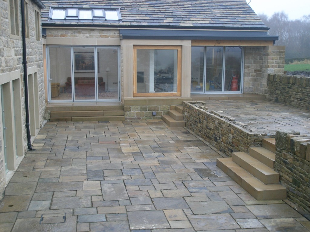 Three sets of steps and 160 square meters of flagstones.  The pointing is still to be done between the flagstones, but we are going to have to wait for some better weather.  The lights are still to be installed (although the holes and wiring have been put in place).
