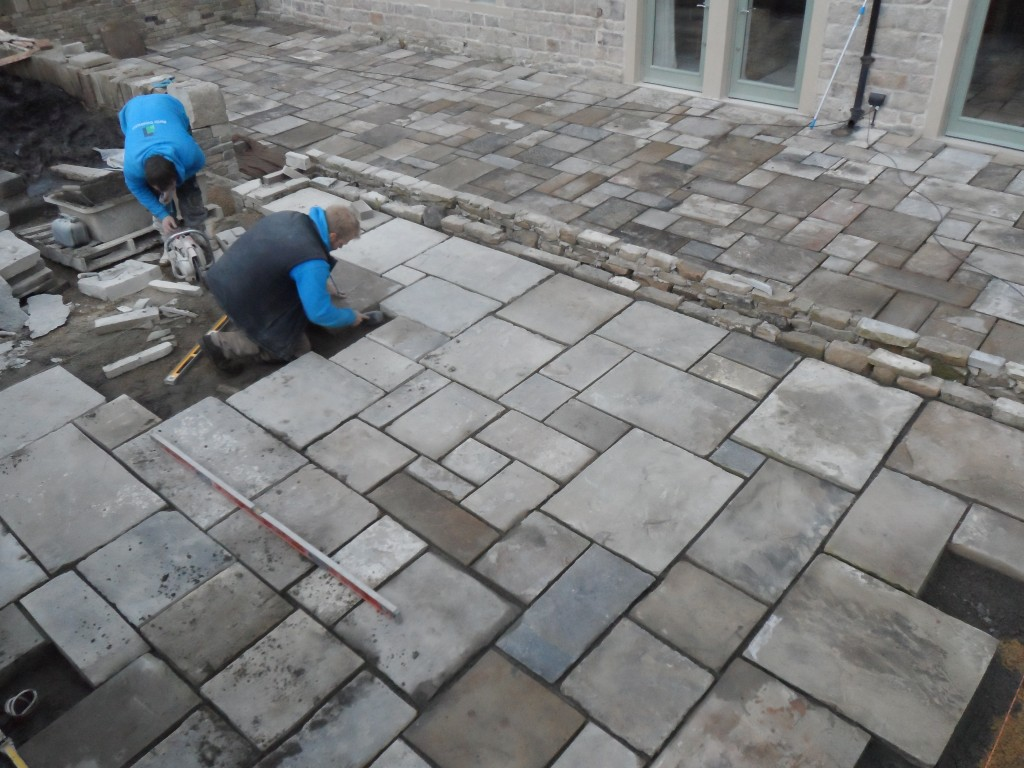 The upper terrace is significantly smaller than the lower terrace hence progress has been that bit quicker.  We will not be able to finish this area though until the stone arrives for the ashlar steps.  It could be another couple of weeks before that arrives.