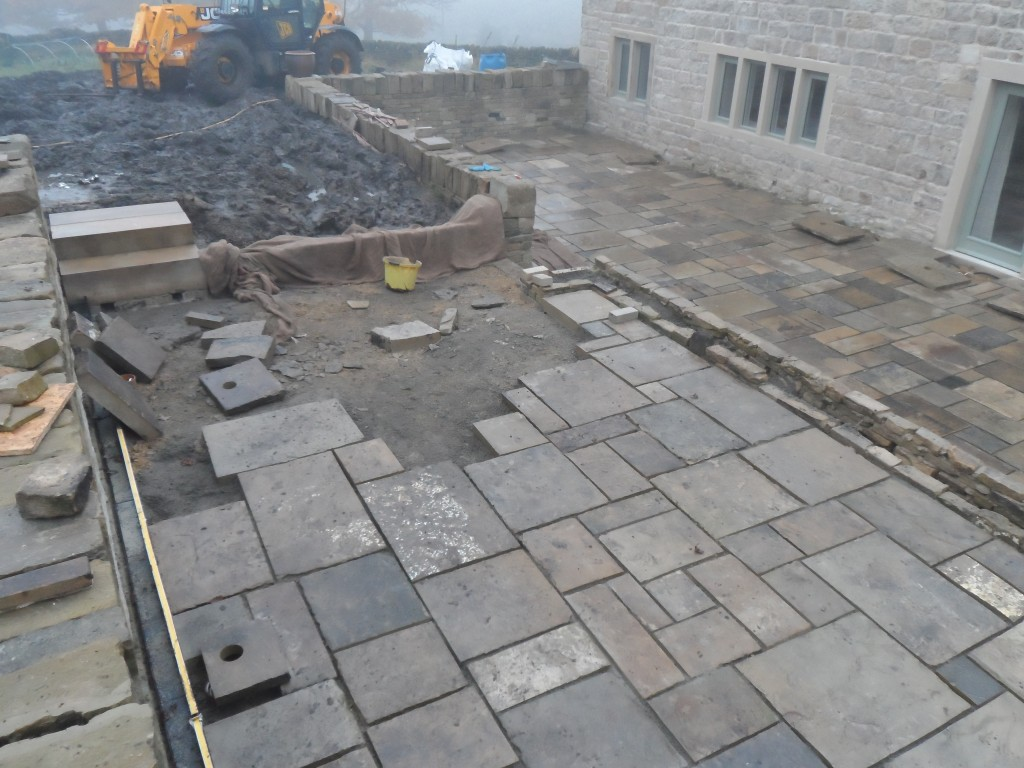 The last of the has been completed so that the flagstones can be laid on the upper terrace.  This small wall can't be seen (it is under the hessian) as it is being protected from the wet weather that we have had today.  We have also had the holes drilled to take the lights in both the lower and upper terraces.