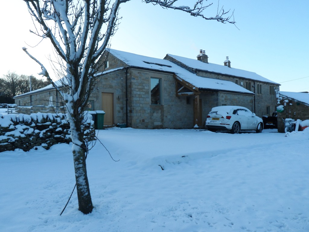 Front of the house in the winter snow