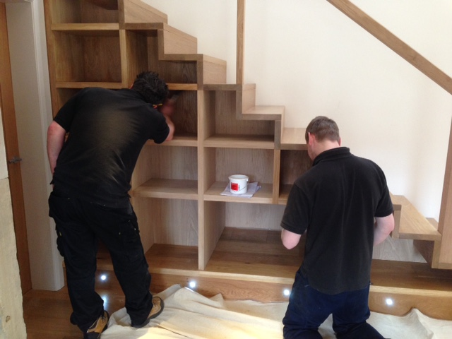 Craig and Jake from Huddersfield Joinery (this is all their handy work!) varnishing the newly installed shelving.