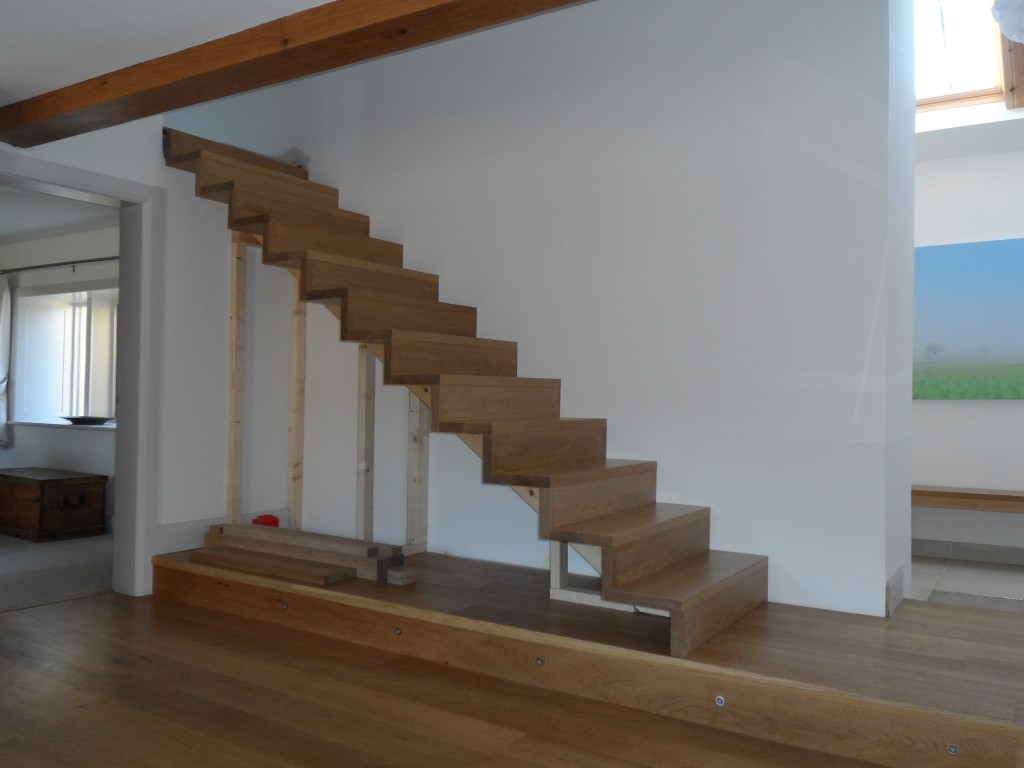 Only the top step is left to install.  The space under the stairs will house book shelves.