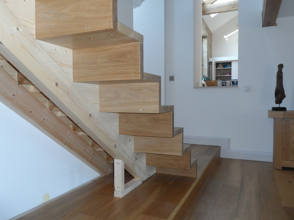 "The treads and risers seem to ""float"" over the edge of the internal splines.  This staircase feels so much more solid that the temporary one we had installed before."