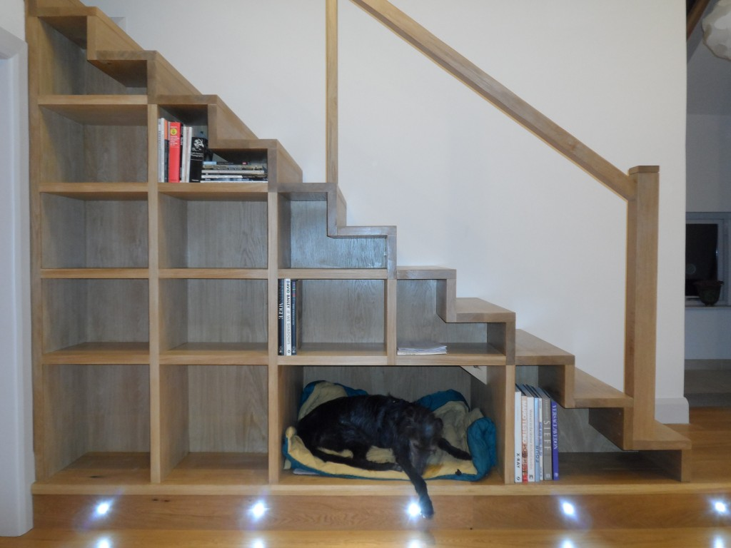 The dog took to sleeping underneath the stairs when the temporary stairs were in place.  We have separate divider where the dog's bed is situated - if we ever don't have a dog, the divider can be slid in so that it looks like the rest of the shelving.