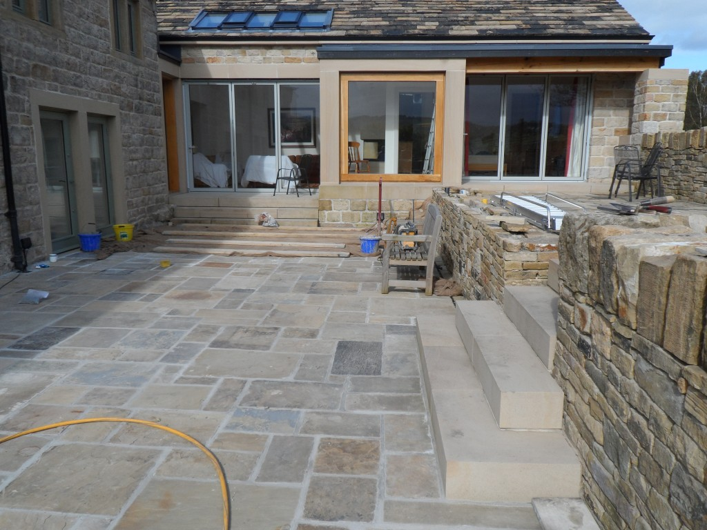 Now the weather has improved we have started pointing the patio.  We are using the same lime based pointing that we used on the house.  The fresh pointing is protected from the rain and the frost overnight with a large sheet of hessian.