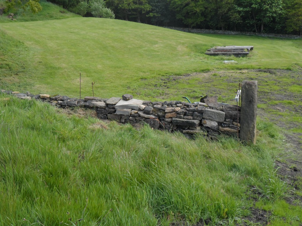 The wall to the right of the gate was non-existent next to the gate post.  We have used all sorts of odd stone to build it up.  Once it weathers in, you would think that it had been there for a hundred years.