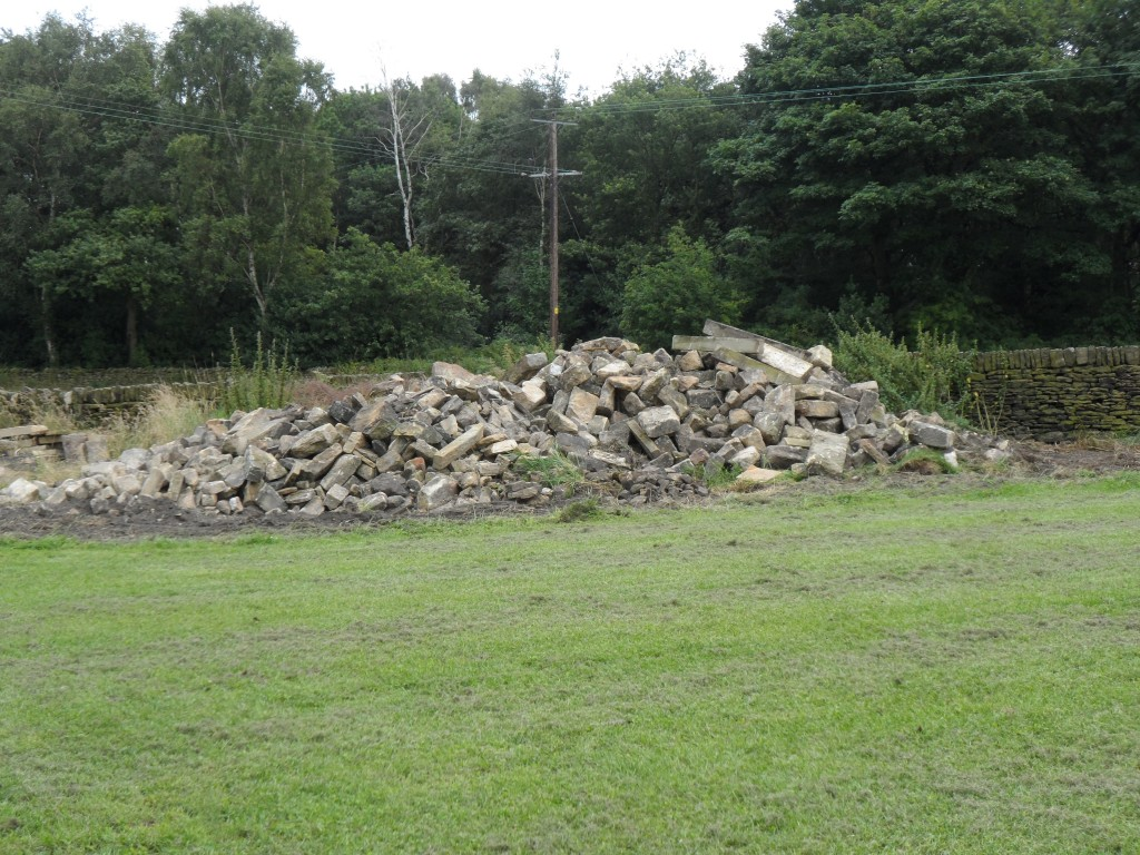 "We are still ""raiding"" this pile of stone left over from the renovation to rebuild and repair different bits of our dry stone walls."