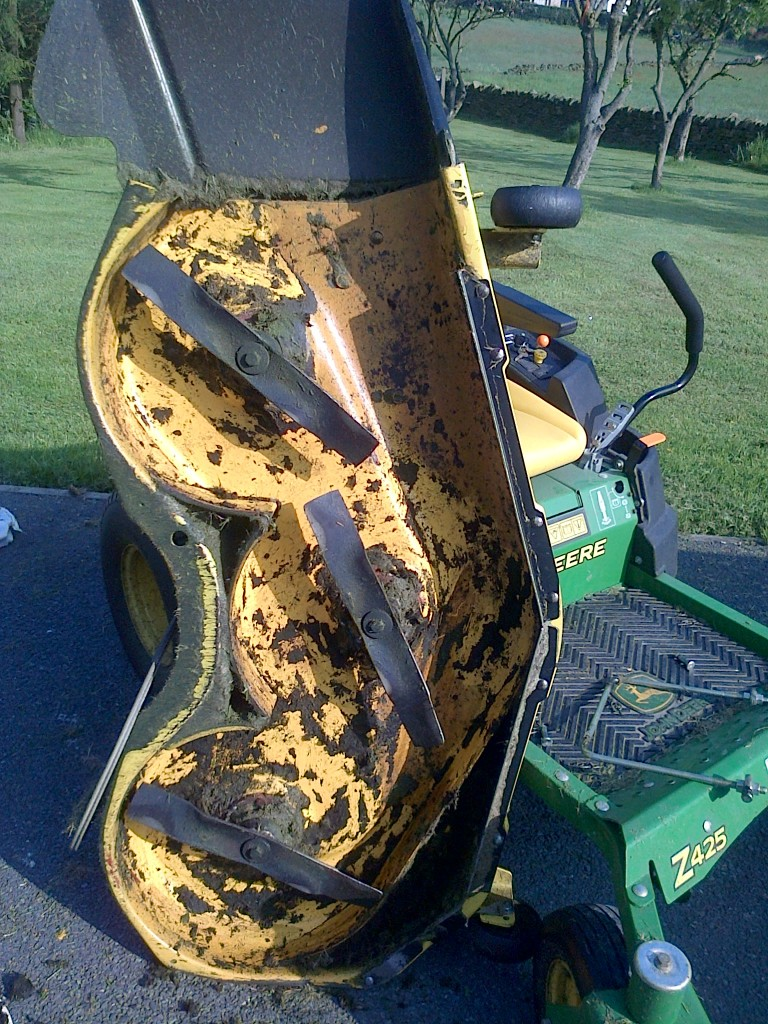 Fortunately, there was no real damage done and it only took a few minutes to cut away the old rope.  It actually took longer to get the mowing deck off the mower!  I took the opportunity to clean out the grass and hose down the underside of the mower deck.