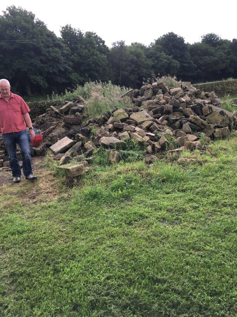 A little while ago we were wondering what we were going to do with the pile of stone from the old barn.  Now, it has almost all gone.