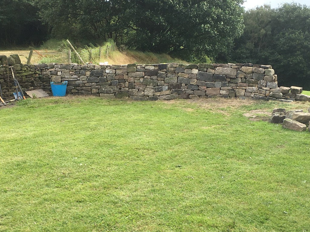We are using our old dumper to move this stone from the mountain to the other end of the field.  The stone is pretty reasonable walling stone (even if some of it is a little big!), so the wall goes up pretty quickly.