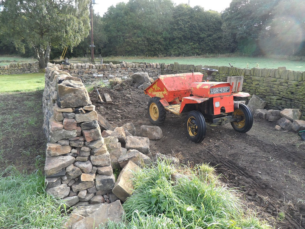 Over the last few weeks we have made good progress on the remaining dry stone walls.  We haven't got much to do now.  Which is just as well, since there isn't much of our mountain of stone left!