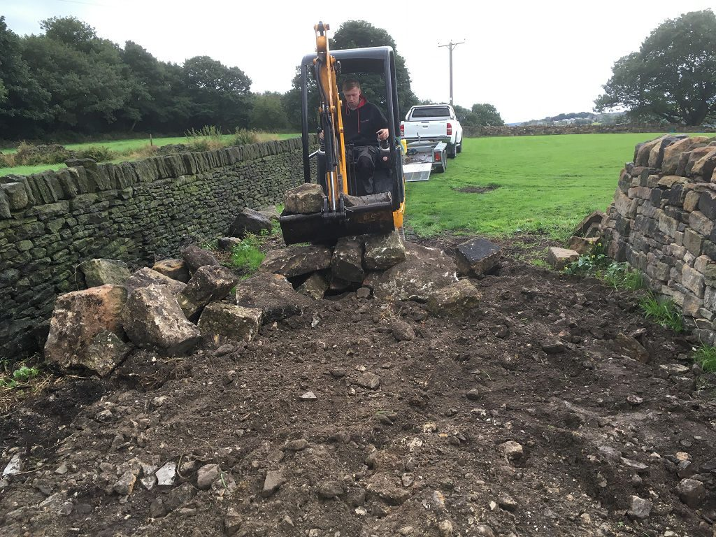 Well, we didn't quite move ALL the stones by hand.  Some of them were just too big to lift by hand!